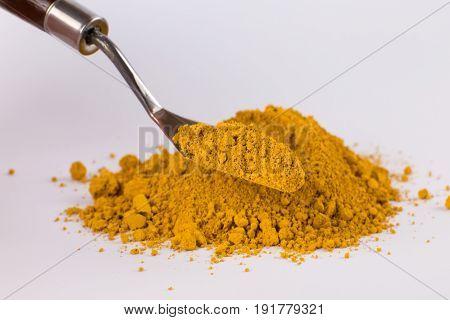 light ocher pigment on a white background