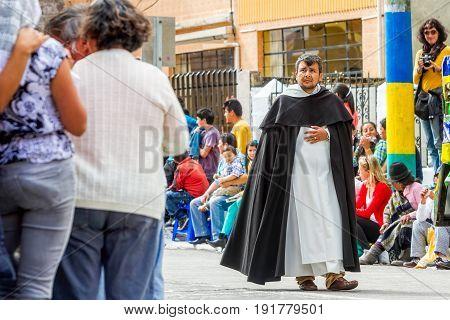 Banos De Agua Santa Ecuador - 29 November 2014: Catholic Priest Carrying A Ritual Along The Streets Of Banos De Agua Santa South America December Festival On November 29 2014