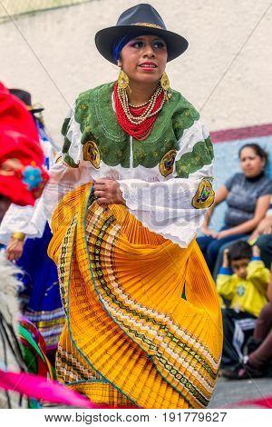 Banos De Agua Santa Ecuador - 29 November 2014:Indigenous woman dancer is dancing on the streets of Banos de Agua Santa South America Christmas Holiday On November 29 2014