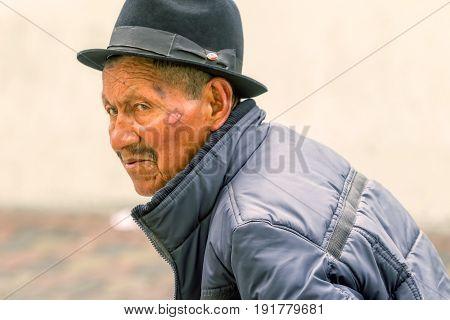 Banos De Agua Santa Ecuador - 29 November 2014: Portrait Of An Old Indigenous Man On The Streets Of Banos De Agua Santa South America Christmas Carnival On November 29 2014