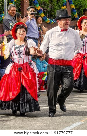 Banos De Agua Santa Ecuador - 29 November 2014: Group Of Latino People From Ecuador Dancing On The Streets Of Banos De Agua Santa South America On 29 November 2014