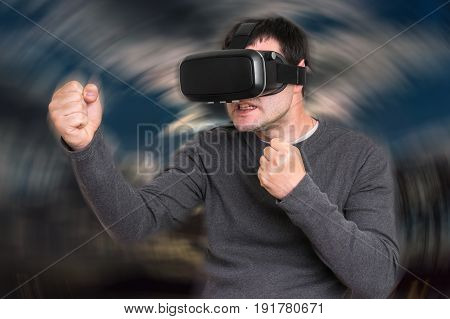 Man With Virtual Reality Goggles Is Playing 3D Games