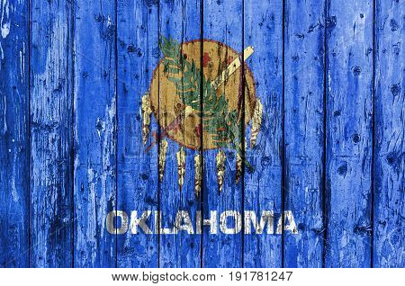 Flag of Oklahoma painted on wooden frame