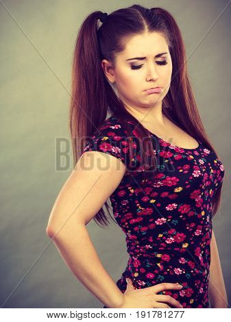 Young teenage woman being offended by something feeling unhappy. Adolescence problems concept.