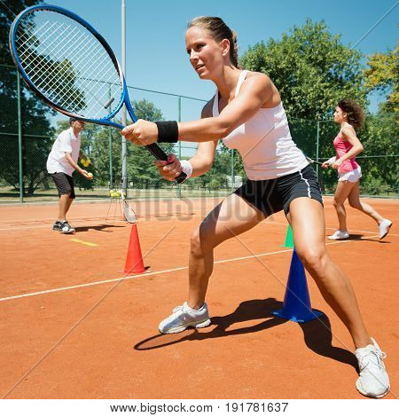 Cardio tennis workout outdoors, color image, square image