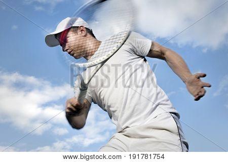 Tennis player against sky