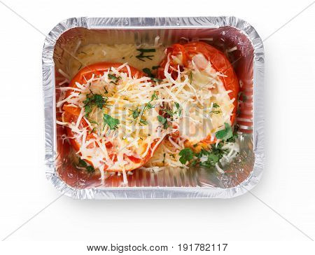 Healthy restaurant lunch. Daily take away meals. Fitness nutrition, weight loss diet. Baked tomatoes with low fat cheese and greens in foil box. Isolated on white background, cutout