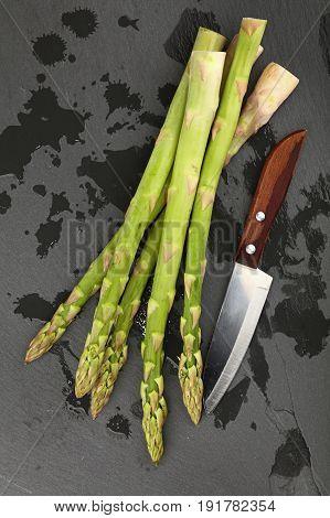 Fresh Green Asparagus On Black Slate Board Closeup