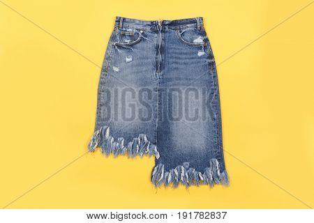 Blue denim shorts isolated on yellow background