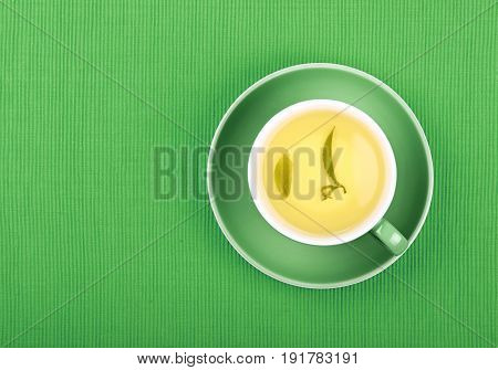 Full Cup Of Green Tea Close Up Elevated Top View