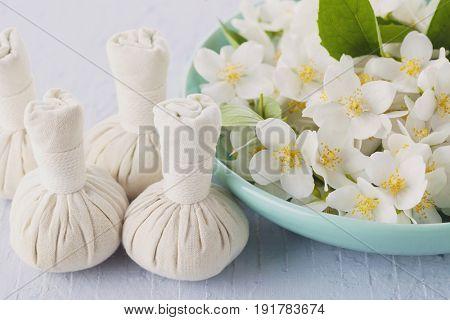 thai herbal compress massage with jasmine flowers - beauty treatment