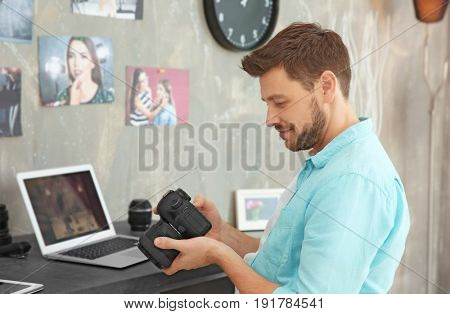 Young photographer looking at picture on camera display