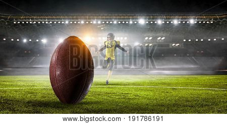 Kicker player on position. Mixed media