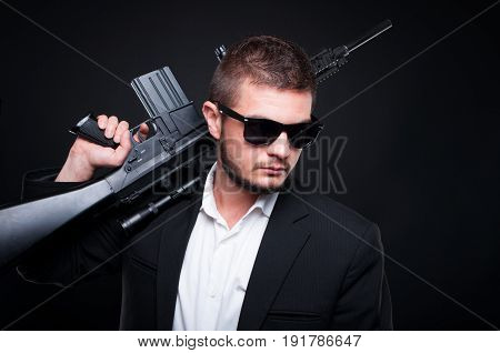 Handsome Young Man Holding A Firearm