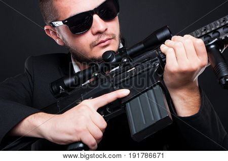 Expert Hitman Posing With Rifle On His Hands