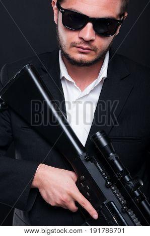 Portrait Of Man With Machine Gun In Hands