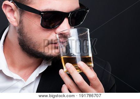 Closeup View Of Exclusive Guy Drinking Fine Scotch