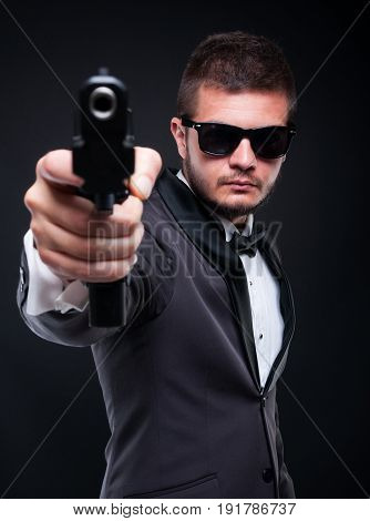Violent Gangster Aiming With Gun At You