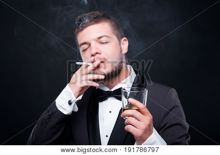 Portrait Of Male Toasting With Glass Of Whiskey