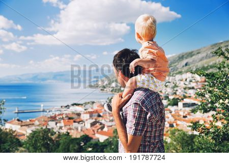 Father And Son On Backgrounds Of The Croatian Seacoast.