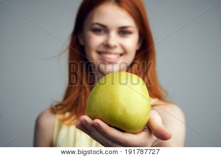 Healthy food, apple, food, diet, woman with apple on gray background.