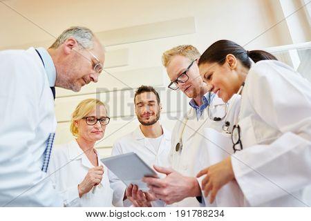 Team of doctors analyzes patient record in meeting