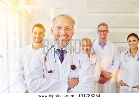 Chief physician and his successful team at hospital
