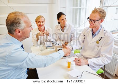Doctors welcome patient to consultation at hospital