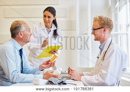 Doctors and patient in consultation giving medicament advice for therapy