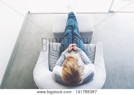 Over The Shoulder View Of Person Relaxing