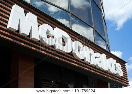 MINSK, BELARUS - june 16, 2017: Logo above the entrance to McDonald's Restaurant. McDonald's is the world's largest chain of hamburger fast food restaurants