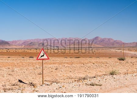 Warning sign with gazelle symbol on the road to Solitaire on the Namib desert Namibia Africa.