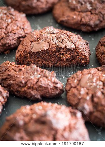 Grain free (gluten free) double chocolate cookies sprinkled with salt close up.