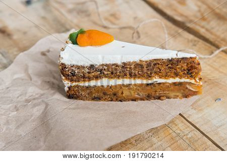Close up delicious freshly backed carrot cake with small carrot on top
