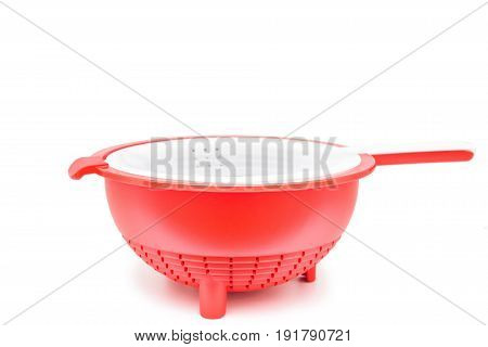 Close up modern red and white plastic colander isolated