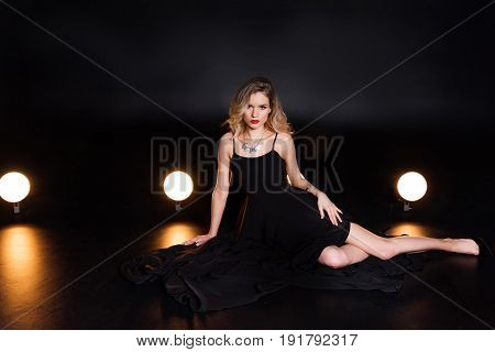 Beautiful Young Blonde Woman In Evening Gown Posing And Looking At Camera