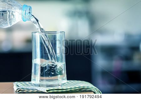 Glass of purified water on the table bar in kitchenroom