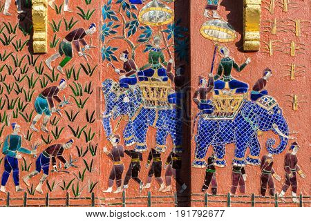 Mosaics at Red chapel at Wat Xieng Thong temple complex in Luang Prabang, Laos