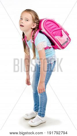 Tired school girl child with heavy backpack isolated on a white background