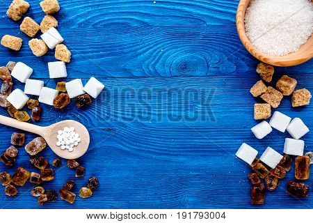 lumps of sugar with bowls sweet set on blue kitchen table background top view mockup