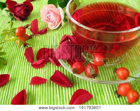 Fruit tea with rose hips and rose flowers