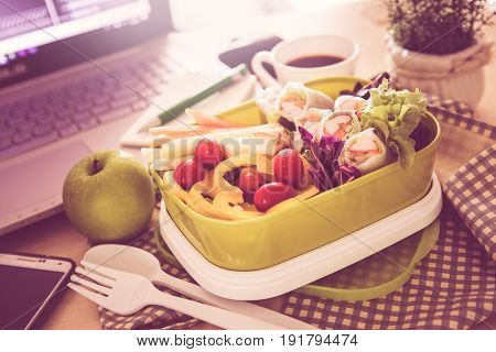 Close up green Lunch box on work place of working desk Healthy eating clean food habits for diet and health care concept vintage and retro color tone