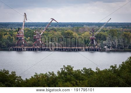 Yanov Backwater with old cranes in Chernobyl Exclusion Zone Ukraine