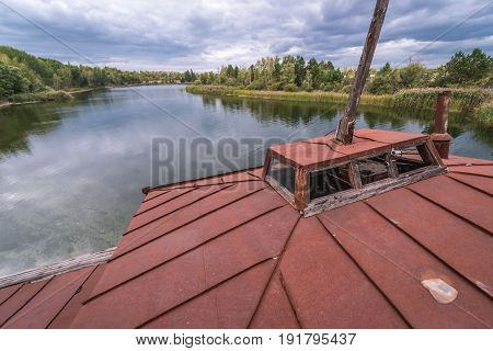 Roof of floating boat on a Yanov backwater in abandoned Pripyat city Ukraine