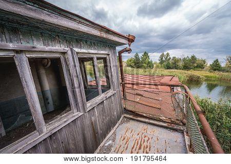 Floating boat on a Yanov backwater in abandoned Pripyat city Chernobyl Exclusion Zone Ukraine
