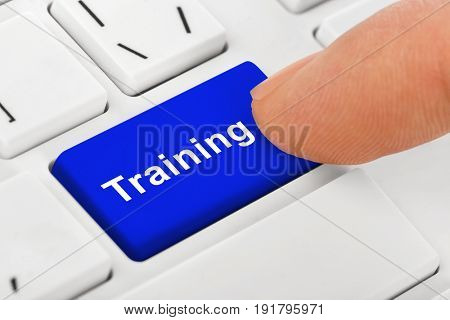 Computer notebook keyboard with Training key - technology background