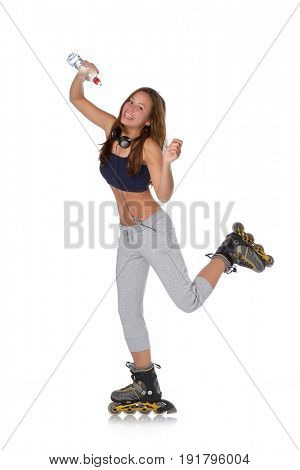 The beautiful girl with water bottle in rollerskates on a white background.