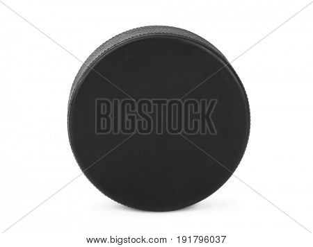 Ice hockey puck isolated on white background