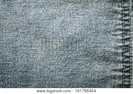 Close up denim blue jeans surface with seam texture background