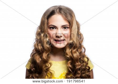 Portrait of crazy angry girl with wavy hairstyle and yellow t shirt. studio shot isolated on white background.